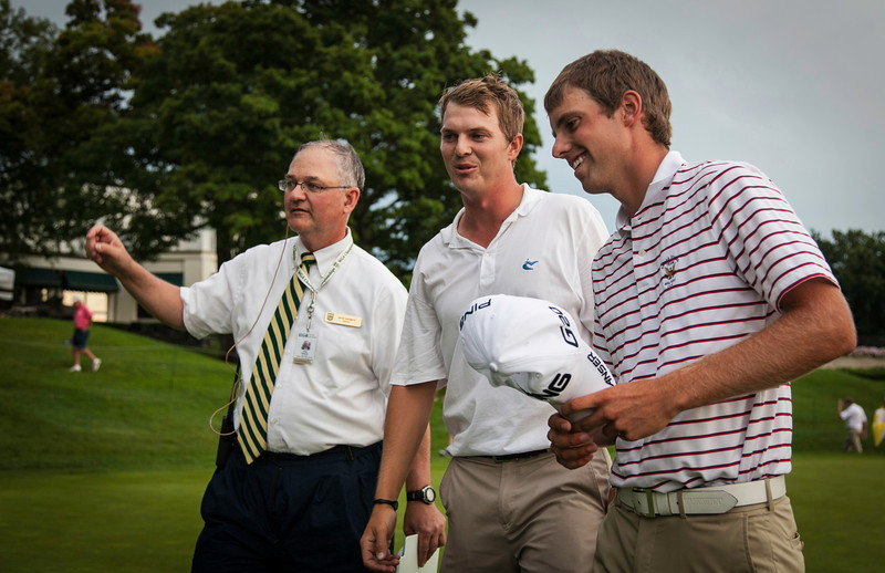 Chris Williams (right) with Jordan Russell and David Haverick WGA lead rules official after Williams won 1 up to win the 2012 Western Amateur Championship at Exmoor Country Club in Highland Park IL. on Saturday, August 4, 2012. (WGA Photo/Charles Cherney)