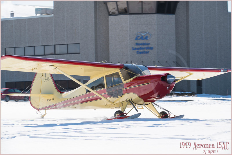 180210_0875 HiRez 1949 AERONCA 15AC lands on skis in front of EAA Museum.jpg