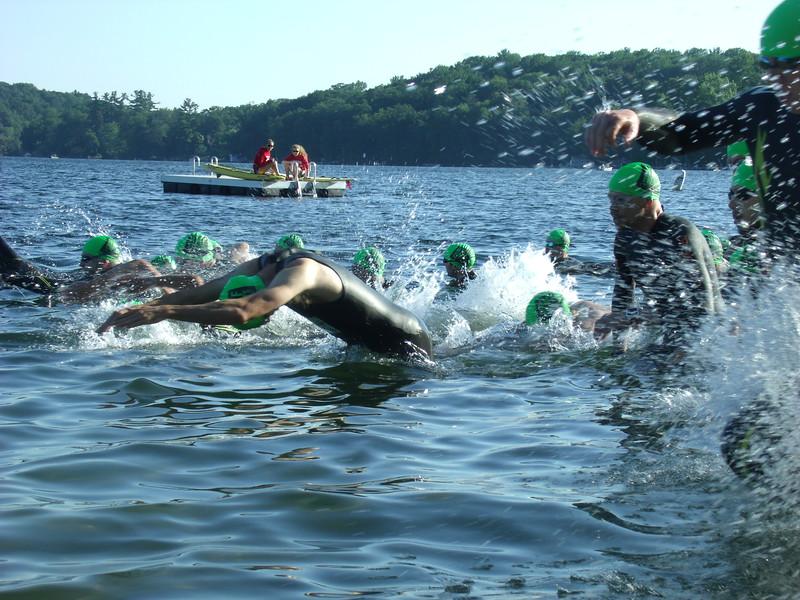 TRIATHALON - Triathletes dive into West Hill Lake for the 1.5 kilometer swim to kick off their triathalon.JPG