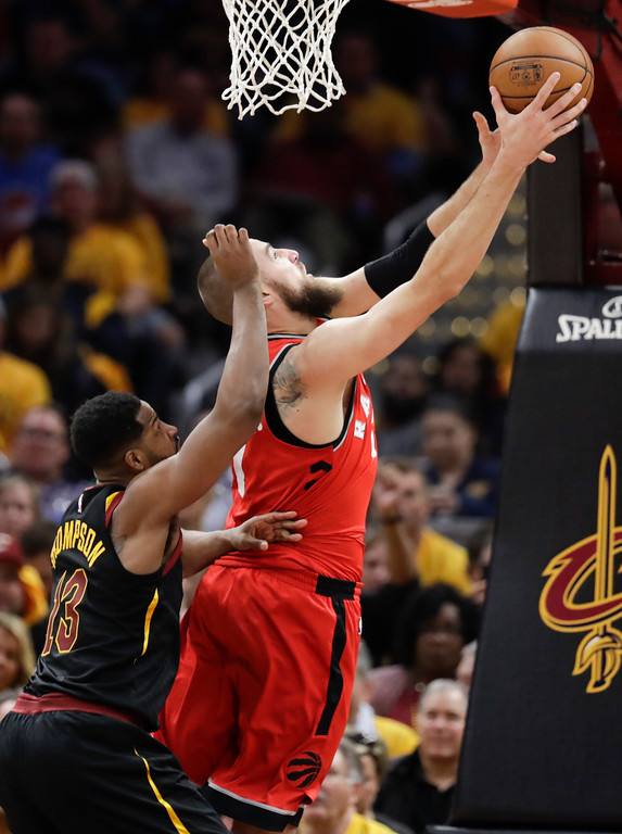 . Toronto Raptors\' Jonas Valanciunas, from Lithuania, shoots against Cleveland Cavaliers\' Tristan Thompson (13) in the first half of Game 4 of an NBA basketball second-round playoff series, Monday, May 7, 2018, in Cleveland. (AP Photo/Tony Dejak)