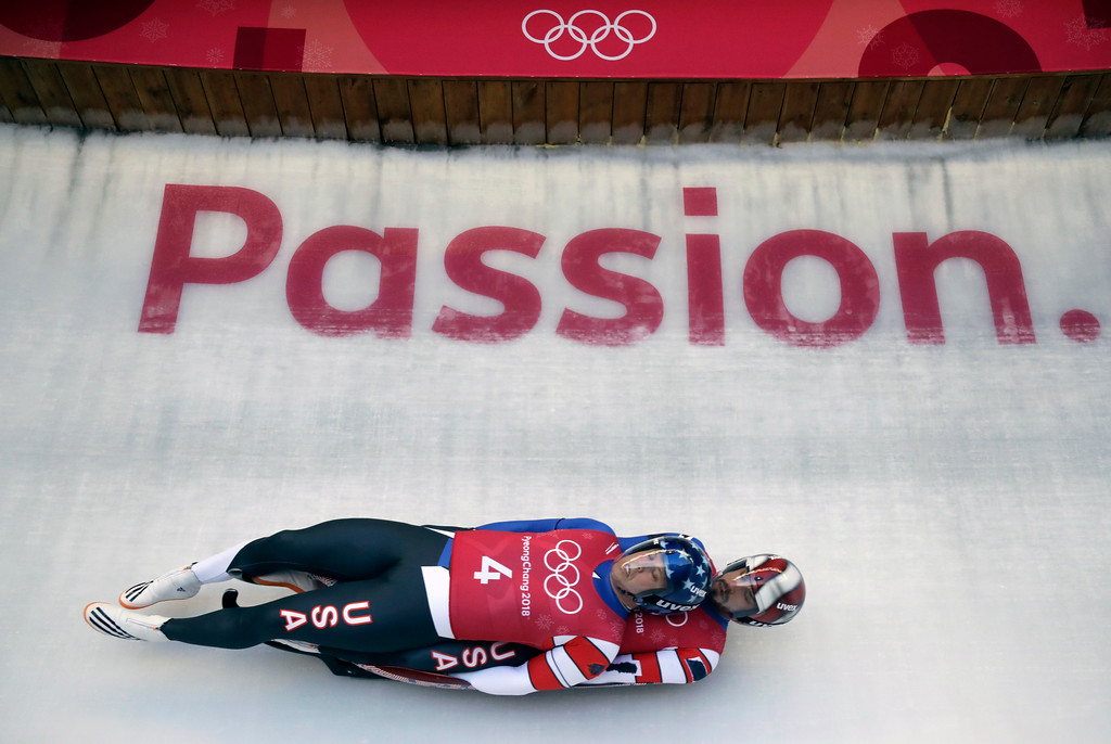 . Matthew Mortensen and Jayson Terdiman of the United States take a practice run during the doubles luge training at the 2018 Winter Olympics in Pyeongchang, South Korea, Monday, Feb. 12, 2018. (AP Photo/Wong Maye-E)