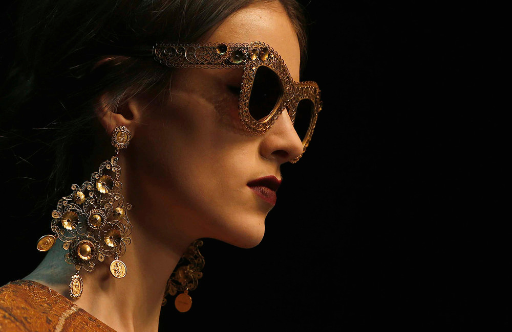 Description of . A model displays a creation from Dolce & Gabbana's Autumn/Winter 2013 collection at Milan Fashion Week February 24, 2013.  REUTERS/Tony Gentile
