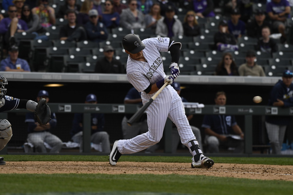 . DENVER, CO. - APRIL 08: Trevor Story (27) of the Colorado Rockies hits a solo home run in the ninth inning. The Colorado Rockies played the San Diego Padres Friday, April 8, 2016 on opening day at Coors Field in Denver, Colorado. (Photo By Andy Cross/The Denver Post)