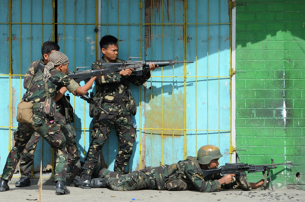 . Philippine soldiers fire towards enemy position during a fire fight between government forces and Muslim rebels as stand-off entered its fourth day in Zamboanga City on the southern island of Mindanao on September 12, 2013. AFP PHOTO/TED ALJIBE/AFP/Getty Images