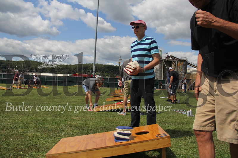Dan Baver, part of the 2019 Leadership class, gathers cornhole sacks on Saturday in Pullman Park