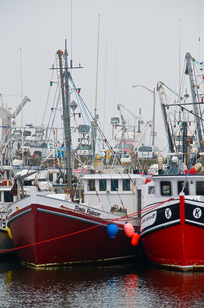 """Two VERY red boats at the next dock over from """"The Cat"""""""