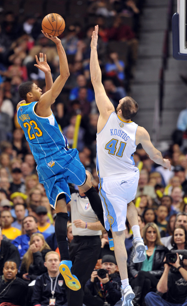 . DENVER, CO. - FEBRUARY 01: Anthony Davis of New Orleans Hornets #23 jumps for the basket over Kosta Koufos of Denver Nuggets #41 in the 2nd half of the game on February 1, 2013 at the Pepsi Center in Denver, Colorado. Denver won 113-98. (Photo By Hyoung Chang/The Denver Post)