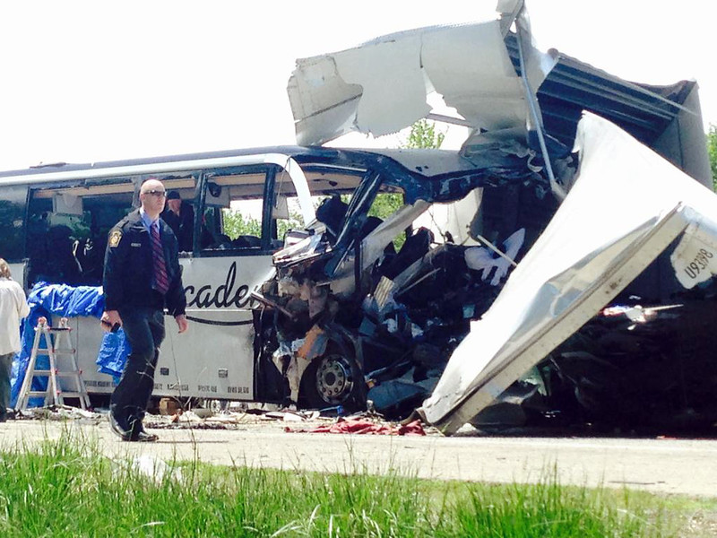 . Authorities investigate the scene of a fatal collision between a tractor-trailer and a tour bus on Interstate 380 near Mount Pocono, Pa., Wednesday, June 3, 2015. Multiple people were killed and more than a dozen were sent to hospitals. (Howard Frank/Pocono Record via AP)