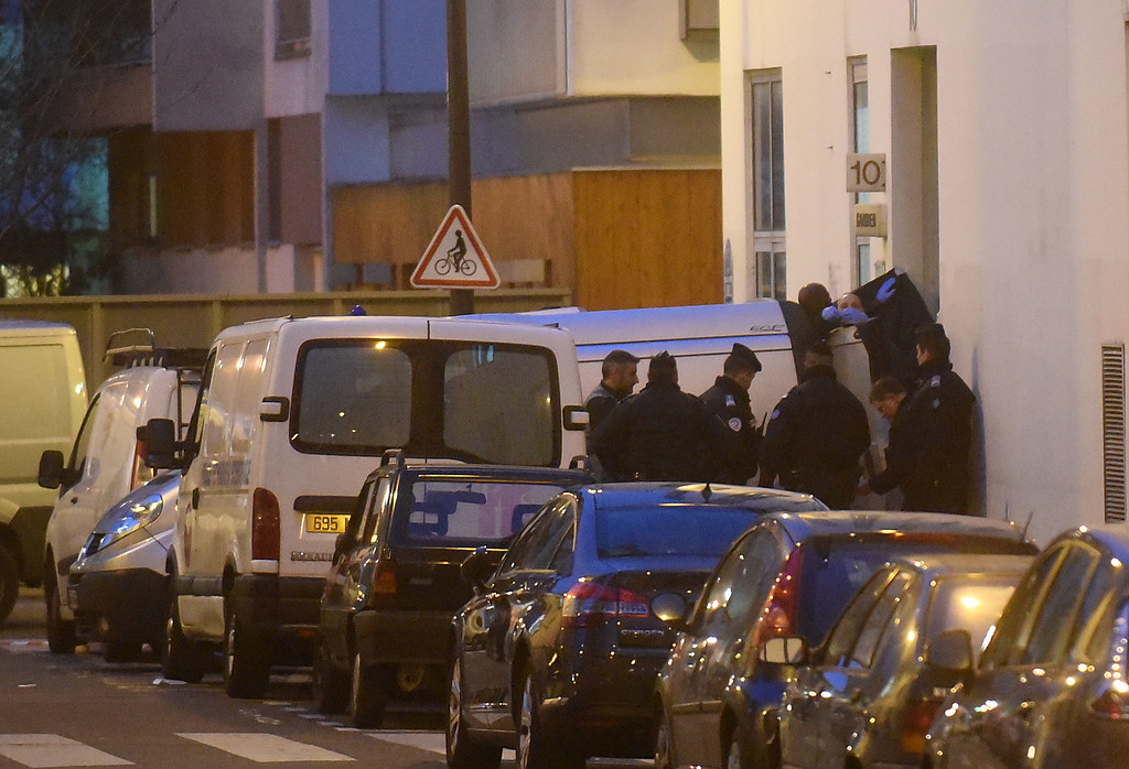 . Police officers reportedly evacuate bodies from the offices of the French satirical newspaper Charlie Hebdo on Nicolas Appert Street on January 7, 2015 in Paris, France. Twelve people were killed including two police officers as two gunmen opened fire at the magazine offices of Charlie Hebdo.  (Photo by Antoine Antoniol/Getty Images)