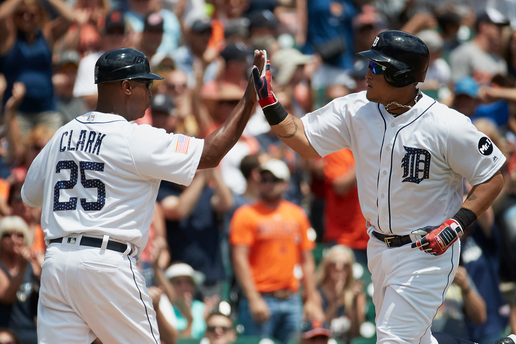 . Detroit Tigers Miguel Cabrera, right, receives congratulations from third base coach Dave Clark (25) after hitting a home run against the Cleveland Indians during the third inning in the first baseball game of a doubleheader in Detroit, Saturday, July 1, 2017. (AP Photo/Rick Osentoski)