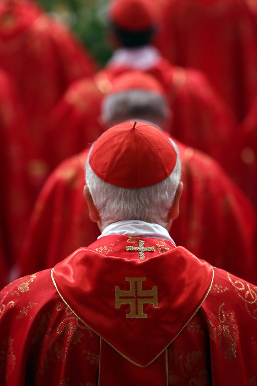 . Cardinals attend the Pro Eligendo Romano Pontifice Mass at St Peter\'s Basilica, before they enter the conclave to decide who the next pope will be, on March 12, 2013 in Vatican City, Vatican. Cardinals are set to enter the conclave to elect a successor to Pope Benedict XVI after he became the first pope in 600 years to resign from the role.   (Photo by Franco Origlia/Getty Images)
