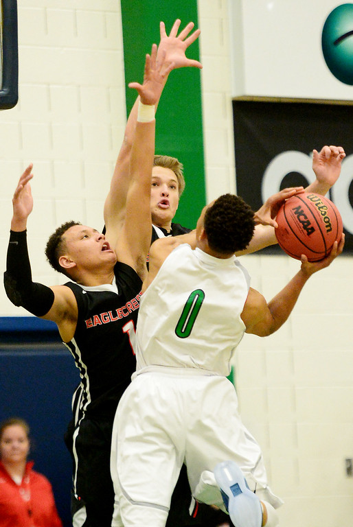 . Nate Bokol (45) of EagleCrest  and Colbey Ross (1) defend Jervae Robinson (0) of Overland during the first half of play. The Overland Trailblazers hosted the Eaglecrest Raptors on Friday, January 8, 2016. (Photo by AAron Ontiveroz/The Denver Post)