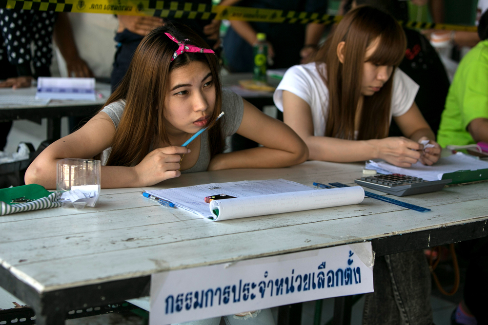 . An election worker waits for voters during the general elections on February 2, 2014 in Bangkok, Thailand.  Anti - government protesters took over government buildings where ballot boxes were stored as an attempt to derail the elections. Bangkok Shutdown has been in effect for over two weeks as the anti-government protesters continue to block major intersections. The Thai government imposed a 60-day state of emergency in Bangkok and the surrounding provinces in an attempt to cope with the on-going political turmoil however this decree has had no effect on the mass protests.  (Photo by Paula Bronstein/Getty Images)
