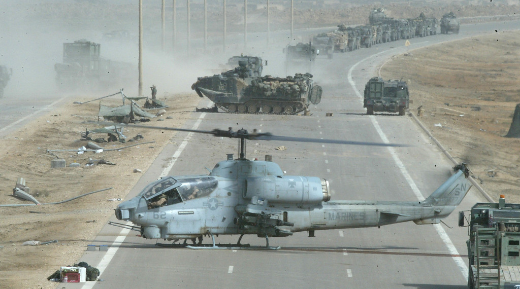 . A U.S. Marine Cobra helicopter prepares to take off after being repaired April 5, 2003 in central Iraq. The Marines continued to sweep through the country looking for enemy forces. (Photo by Joe Raedle/Getty Images)