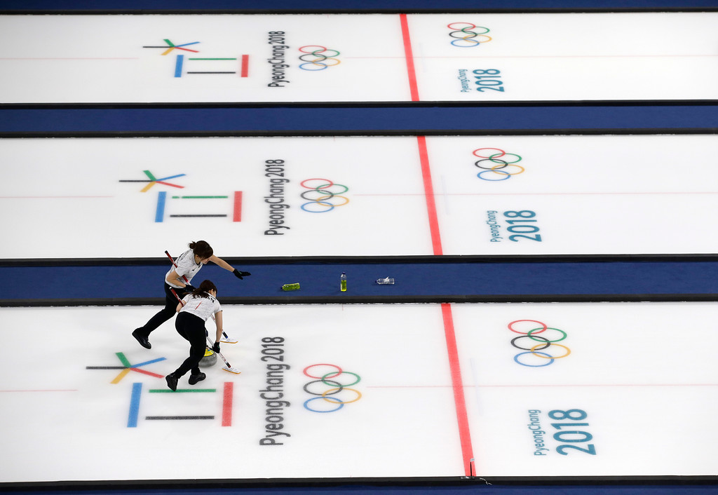 . Japan\'s Yurika Yoshida and Chinami Yoshida, sweeps ice during the womens curling match against Britain at the 2018 Winter Olympics in Gangneung, South Korea, Saturday, Feb. 24, 2018. Japan won the bronze. (AP Photo/Aaron Favila)