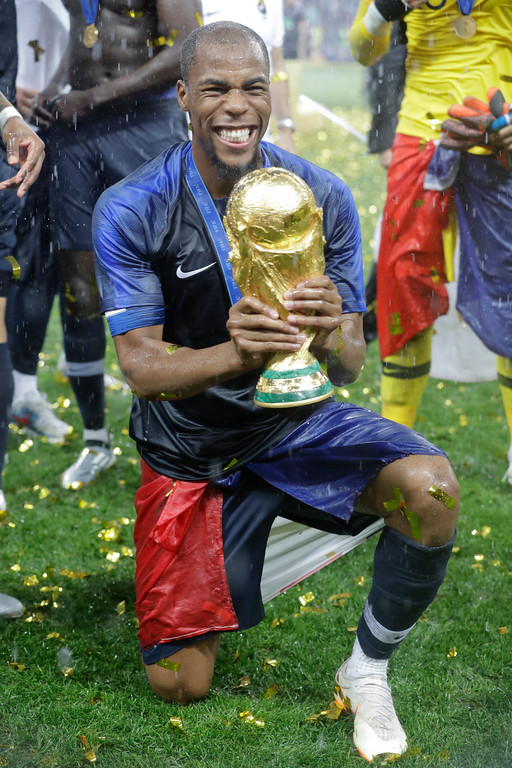 . France\'s Djibril Sidibe holds the trophy at the end of the final match between France and Croatia at the 2018 soccer World Cup in the Luzhniki Stadium in Moscow, Russia, Sunday, July 15, 2018. (AP Photo/Matthias Schrader)