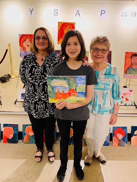 From left, Lisa and artist Lia Custodinho, Terri Orr of Waltham