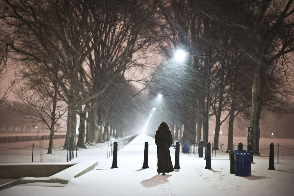 . A woman walks next to the Reflecting Pool in front of the Lincoln Memorial as a heavy snow storm hits Washington D.C. on February 13, 2014. The eastern US, in the grips of one of the most brutal winters in recent memory, braced for what forecasters warned could be the worst broadside yet -- a massive storm with the season\'s heaviest snowfall. AFP PHOTO / MLADEN ANTONOV/AFP/Getty Images