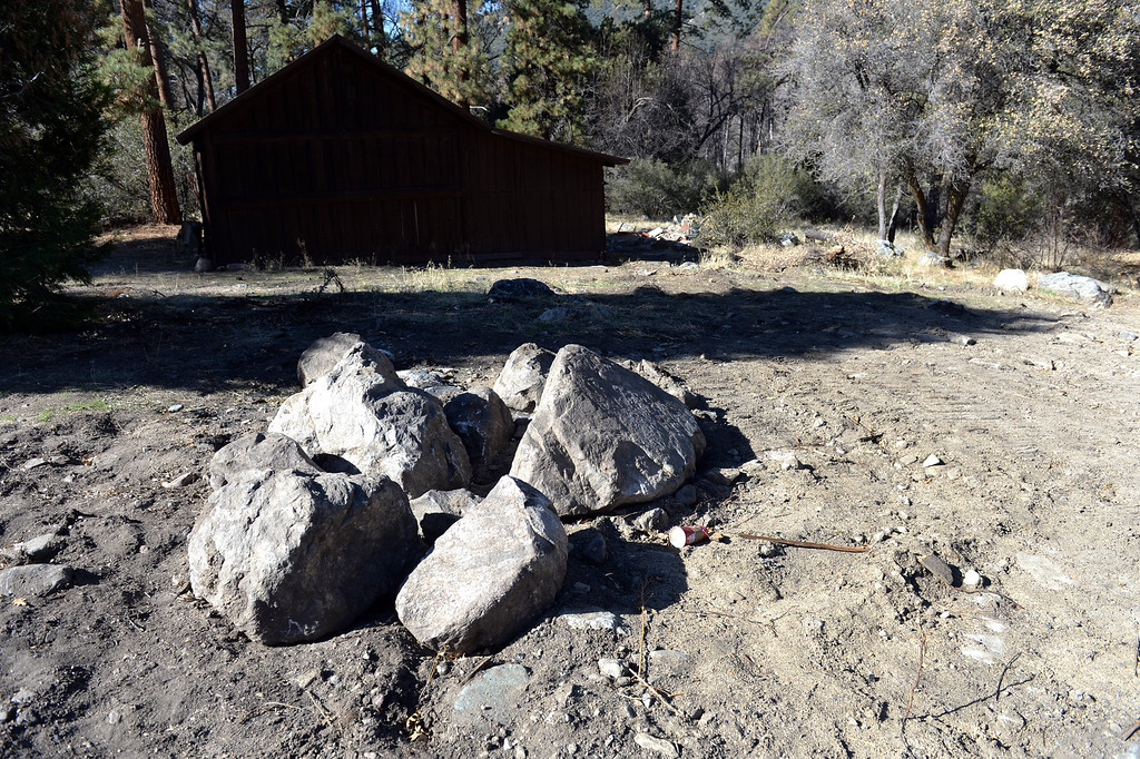 . Nothing remain of the cabin that burned to the ground during the manhunt for former LAPD officer, Christopher Dorner  in Angeles Oak,CA., December 27, 2013. Dorner took refuge in the cabin where he shot and killed San Bernardino County Sheriff\'s Deputy Jeremiah MacKay and wound Deputy Alex Collins. The manhunt lasted more than a week and led to the deaths of four people, including two police officers and an Irvine couple. (John Valenzuela/Staff Photographer)