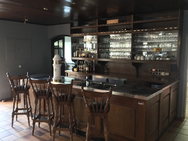 The bar! Two working beers taps, fridges, bar stools and all stemware.