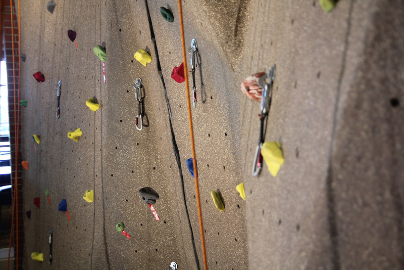 Students climb rock wall for the first time.