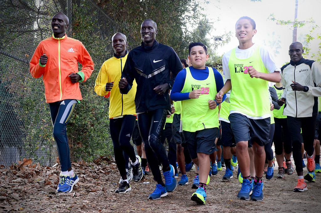 . Elite marathon runners visit with students, who are going to run in Sunday\'s LA Marathon and are part of Students Run LA, at Griffith Park in Los Angeles as the elite runners train Friday, March 7, 2014 for the LA Marathon. (Photo by Sarah Reingewirtz/Pasadena Star-News)