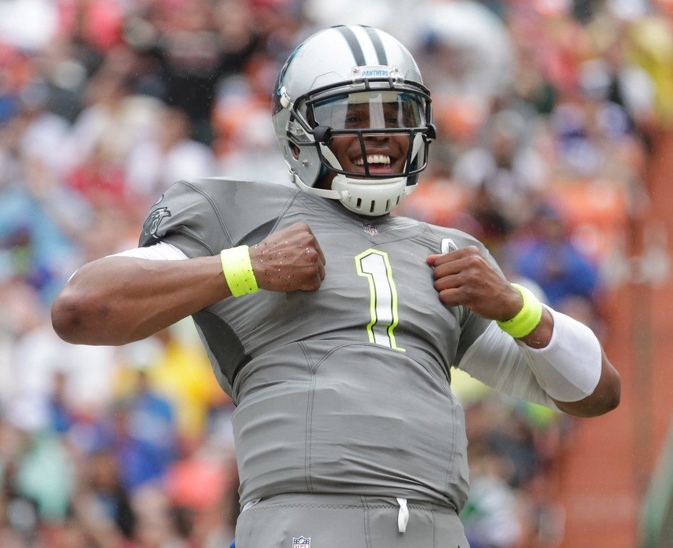 . Carolina Panthers quarterback Cam Newton (1) of Team Sanders celebrates his touchdown in the second quarter quarter of the NFL Pro Bowl football game, Sunday, Jan. 26, 2014, in Honolulu. (AP Photo/Eugene Tanner)