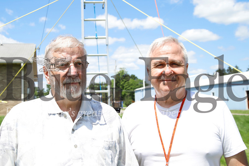 Tom McCracken and Julian Savage stand in front of one of four ham radio antennas. Seb Foltz/Butler Eagle