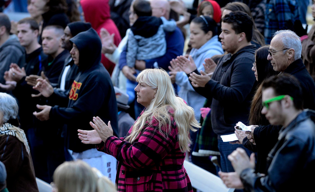 . People raise their hands in worship during Easter Sunrise services at the Roosevelt Bowl in San Bernardino March 31, 2013.  GABRIEL LUIS ACOSTA/STAFF PHOTOGRAPHER.