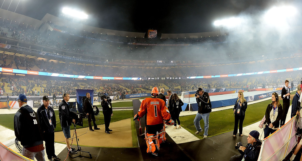 . Anaheim Ducks goalie Jonas Hiller walks off the ice after defeating the Los Angeles Kings 3-0 and bing named one of the stars of the game during the inaugural NHL Stadium Series game at Dodger Stadium in Los Angeles on Saturday, Jan. 25, 2014. (Keith Birmingham Pasadena Star-News)