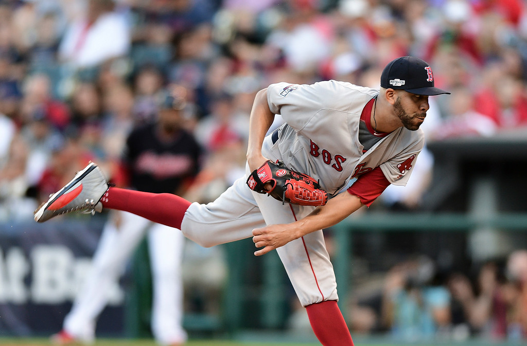 . Boston Red Sox pitcher David Price follows through on a delivery to a Cleveland Indians batter during the fourth inning of Game 2 of a baseball American League Division Series, Friday, Oct. 7, 2016, in Cleveland. (AP Photo/David Dermer)