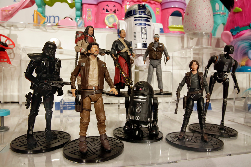 . This Thursday, Oct. 6, 2016, photo shows the Star Wars Rogue One Elite Series characters, from The Disney Store, on display at the annual TTPM Holiday Showcase, in New York. Toy companies are offering products that are more inclusive, from Barbie dolls in all shapes, sizes and skin tones to baby dolls aimed at boys. Toy companies are also offering dolls that represent different disabilities. But still experts and parents say more work needs to be done. (AP Photo/Richard Drew)