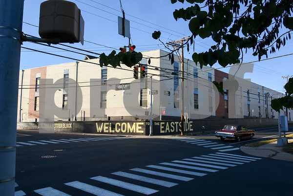 10/18/17 Wesley Bunnell   Staff A car drives down East St. where Building a Better Block Welcome to the Eastside was recently painted on the corner of East & Dwight St. by Paul Baylock and Aaron Pryzbek.