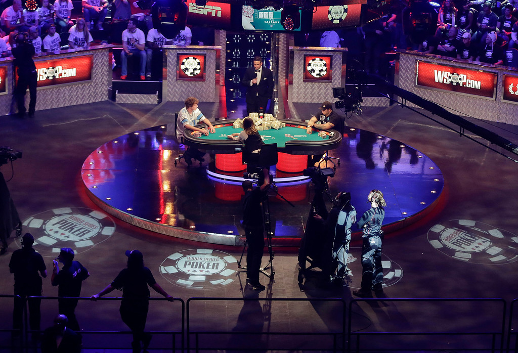 . Ryan Riess, left, and Jay Farber continue play as the two remaining finalists during the World Series of Poker final table, Tuesday, Nov. 5, 2013, in Las Vegas. (AP Photo/Julie Jacobson)