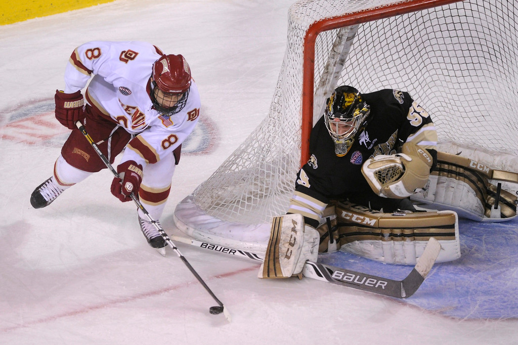 . DENVER, CO. - NOVEMBER 16: Western Michigan goaltender Lukas Hafner put his stick down as Denver left wing Trevor Moore (8) wrapped around the net in the first period. The University of Denver hockey team hosted Western Michigan at Magness Arena Saturday night, November 16, 2013.  Photo By Karl Gehring/The Denver Post
