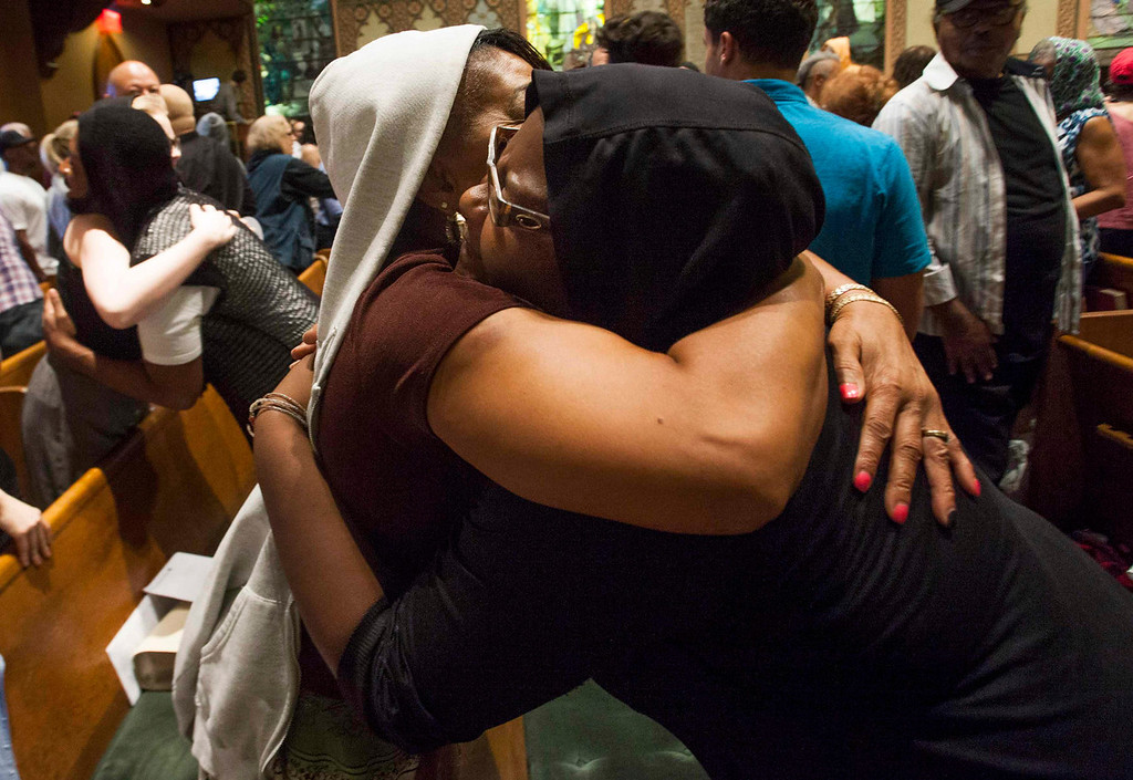 . Worshippers at the Middle Collegiate Church wearing hoodies hug during prayer services in support of slain teenager Trayvon Martin in response to the acquittal of George Zimmerman in his trial in New York, July 14, 2013. A Florida jury acquitted Zimmerman on Saturday for the shooting death of unarmed black teenager Martin, setting free a man who had become a polarizing figure in the national debate over racial profiling and self-defense laws. REUTERS/Keith Bedford
