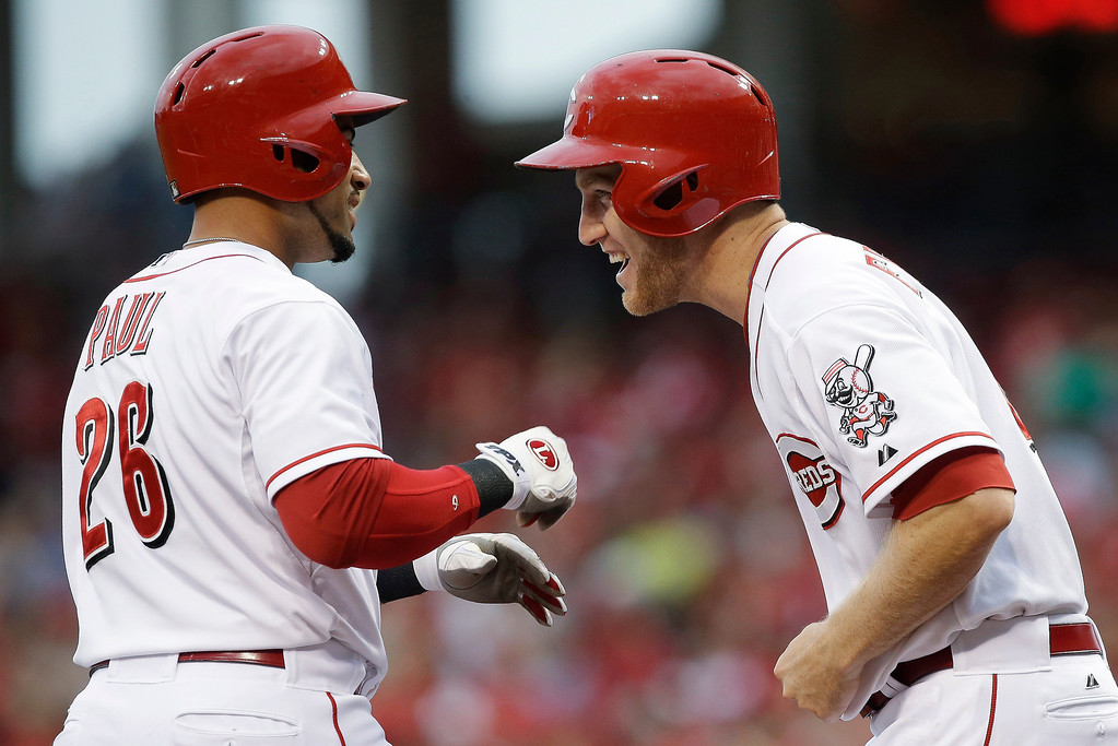 . Cincinnati Reds\' Xavier Paul (26) is met at home by Todd Frazier after Paul hit a three-run home run off Colorado Rockies pitcher Jon Garland in the first inning of a baseball game, Wednesday, June 5, 2013, in Cincinnati. (AP Photo/Al Behrman)