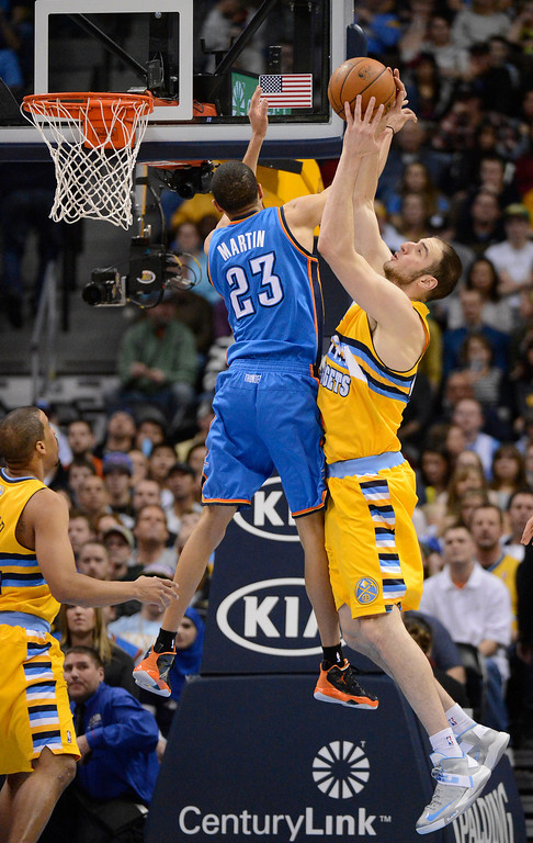 . DENVER, CO. - JANUARY 20: Denver Nuggets center Kosta Koufos (41) pulls down a rebound from Oklahoma City Thunder shooting guard Kevin Martin (23) during the first quarter January 20,  2013 at Pepsi Center. (Photo By John Leyba / The Denver Post)