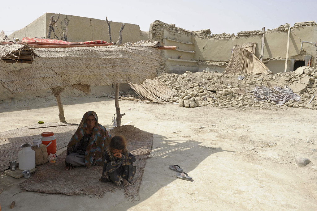 . A Pakistani earthquake survivor sits under a makeshift shelter in the devastated district of Awaran on September 25, 2013. A powerful 6.8-magnitude earthquake hit southwest Pakistan, in a region already devastated by a tremor which left more than 300 people dead and 100,000 homeless less than a week ago.  BANARAS KHAN/AFP/Getty Images