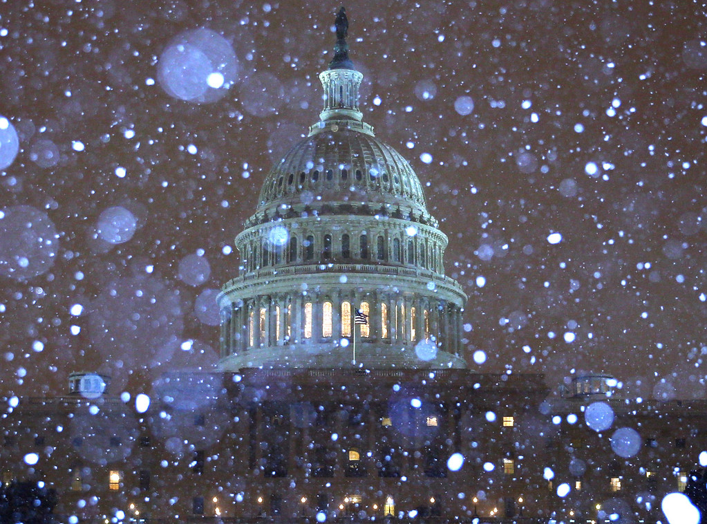 . Snow falls in front of the U.S. Capitol building on February 13, 2014 in Washington, DC. The east coast was hit with a winter snow storm with the Washington area expecting up to 8 inches of snow before it ends.  (Photo by Mark Wilson/Getty Images)