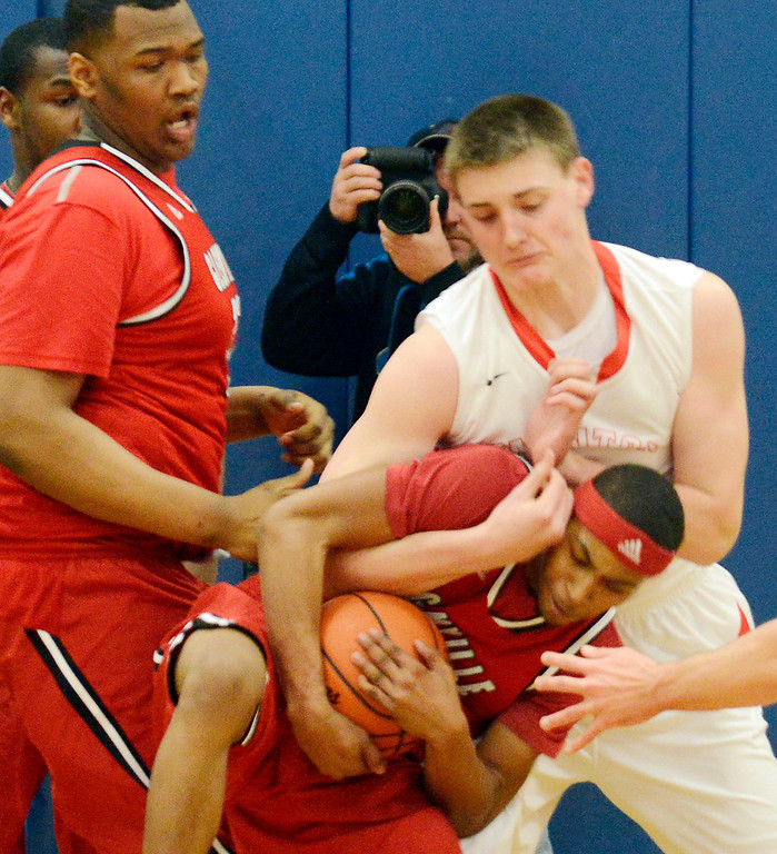 . Maribeth Joeright/MJoeright@News-Herald.com<p> Mentor\'s Micah Potter and Glenville\'s DrayVon Hutchinson battle for the rebound during the first quarter of the Division 1 district semifinal game, March 6, 2014.