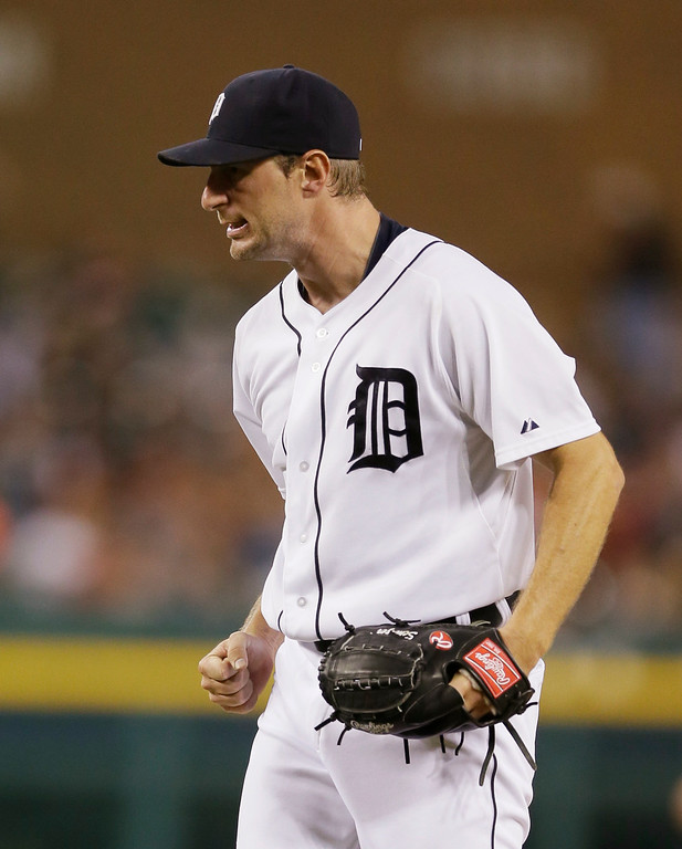 . Detroit Tigers starting pitcher Max Scherzer reacts after striking out Kansas City Royals\' Eric Hosmer to end the top of the fifth inning of a baseball game in Detroit, Tuesday, Sept. 9, 2014. (AP Photo/Carlos Osorio)
