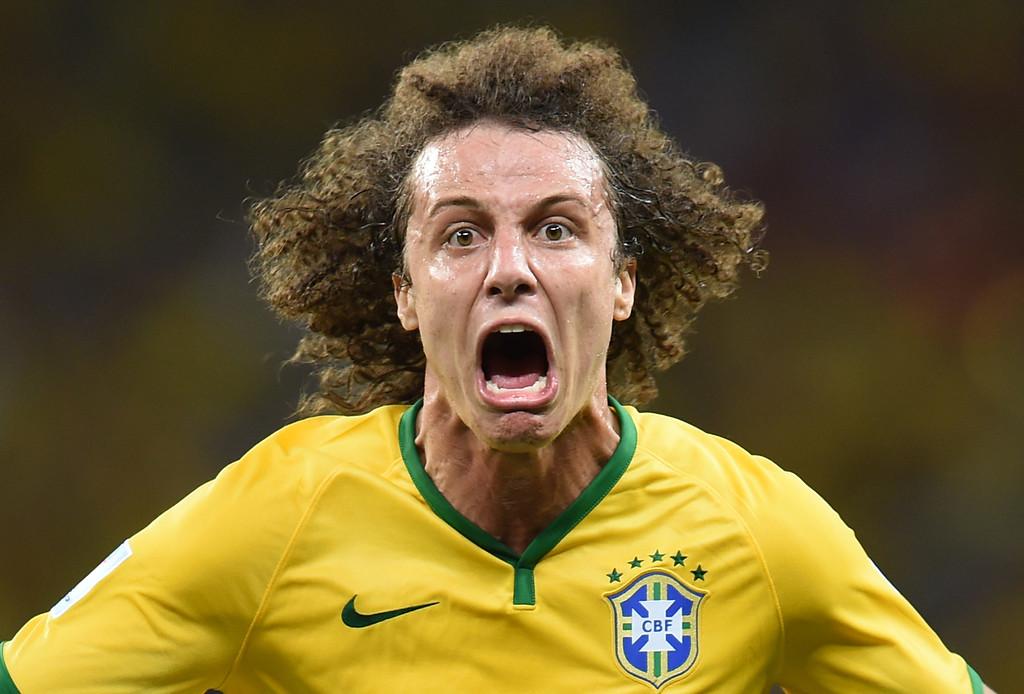 . Brazil\'s defender David Luiz celebrates scoring during the quarter-final football match between Brazil and Colombia at the Castelao Stadium in Fortaleza during the 2014 FIFA World Cup on July 4, 2014. AFP PHOTO / VANDERLEI  ALMEIDA/AFP/Getty Images