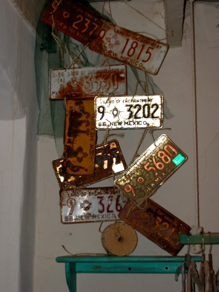 Some funky old license plates in an art shop
