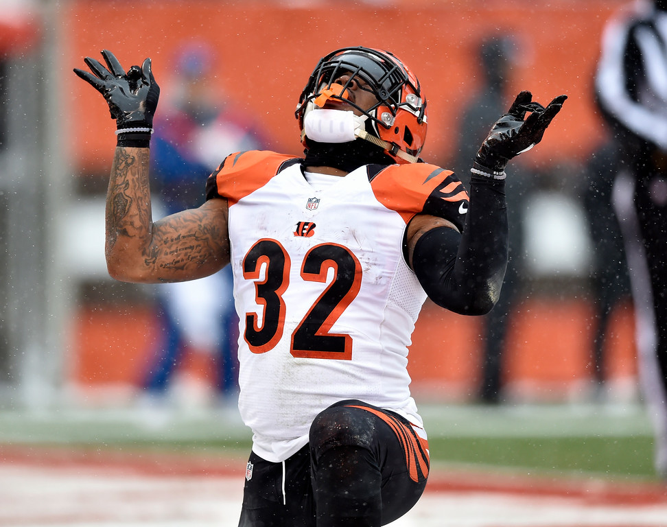 . Cincinnati Bengals running back Jeremy Hill celebrates a 1-yard touchdown in the first half of an NFL football game against the Cleveland Browns, Sunday, Dec. 11, 2016, in Cleveland. (AP Photo/David Richard)