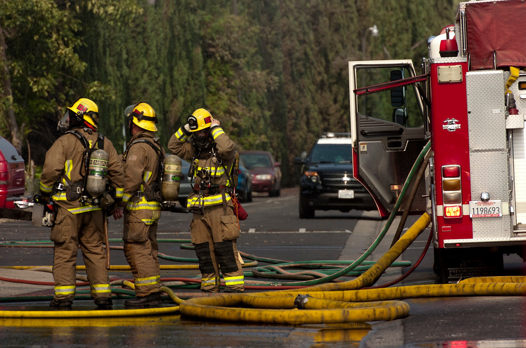 . Ontario firefighters battle a Cypress tree fire at Samoa Village Mobile Home Estates in Ontario, CA, Tuesday, June 10, 2014. (Photo by Jennifer Cappuccio Maher/Inland Valley Daily Bulletin)
