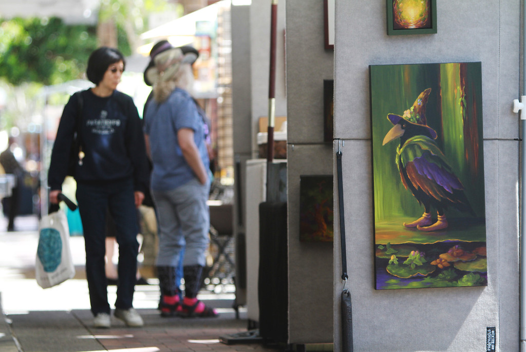 . Artwork is displayed at the 31st annual Sidewalk Fine Arts Festival on Santa Cruz Avenue in downtown Menlo Park on Friday, April 19, 2013. The festival has artworks including painting, jewelry, and sculpture. The festival started Friday and continues to Sunday. The festival is open today, Saturday, from 10 a.m. to 6 p.m. and Sunday from 10 am. to 5 p.m. For more information, visit pacificfinearts.com.  (Kirstina Sangsahachart/ Daily News)
