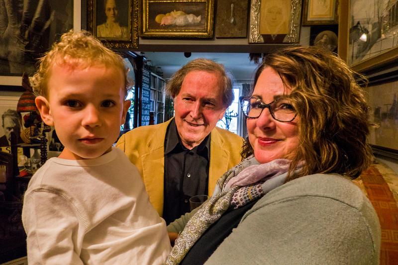 Robert's grandson in Farrah Spott's arms, with Robert in center