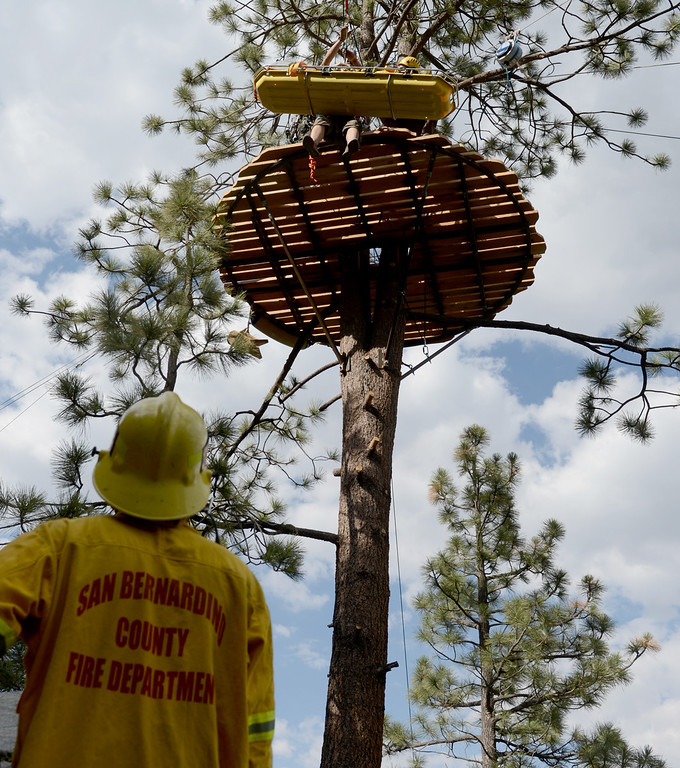 . Navitat Canopy Adventures employees trains in a zip line rescue along with the San Bernardino and Los Angeles county fire depts while doing zip line and helicopter hoist rescues in Wrightwood May 13, 2013. The training will help when hikers get lost or injured and need to be rescued. (Thomas R. Cordova/Staff Photographer)