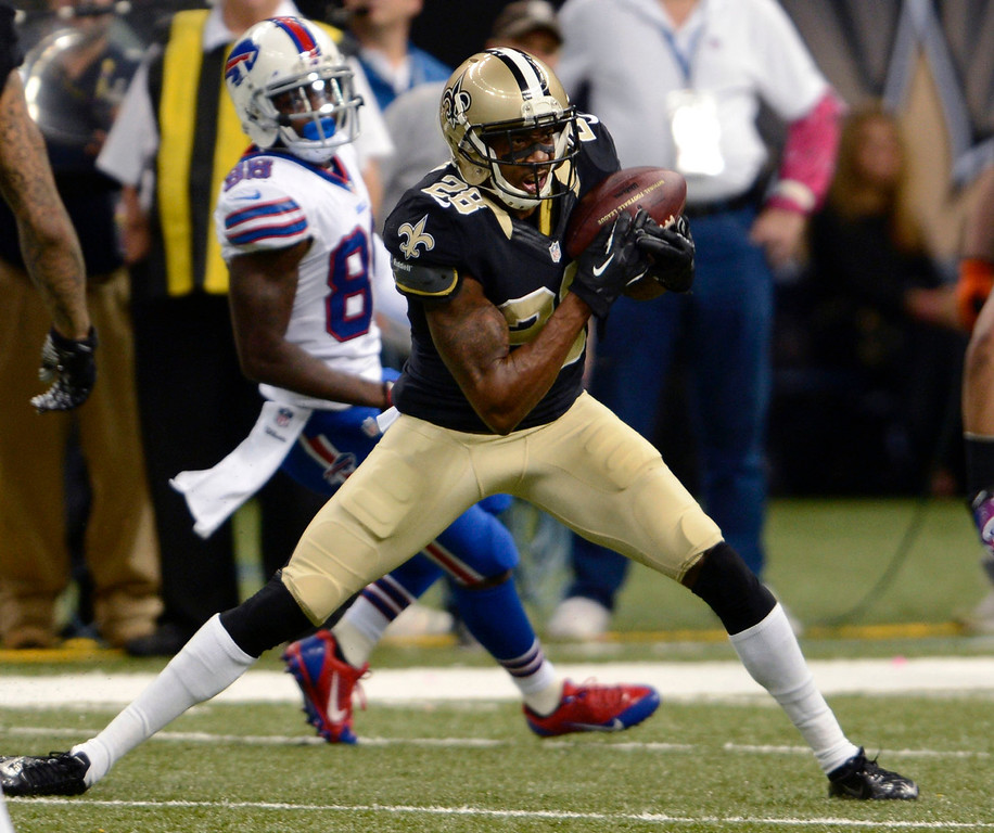 . New Orleans Saints cornerback Keenan Lewis (28) intercepts a pass in front of Buffalo Bills wide receiver Marquise Goodwin (88) during the second half of an NFL football game in New Orleans, Sunday, Oct. 27, 2013. (AP Photo/Bill Feig)